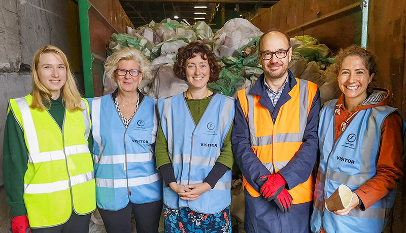 Vegware and Paper Round staff in high vis at a composting facility